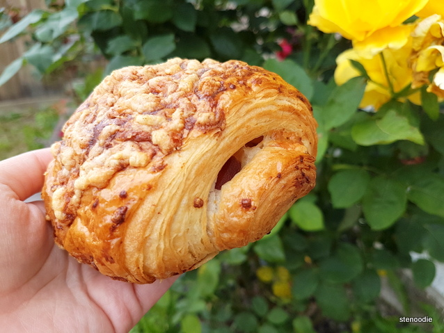 Pork Belly & Cheddar croissant in hand