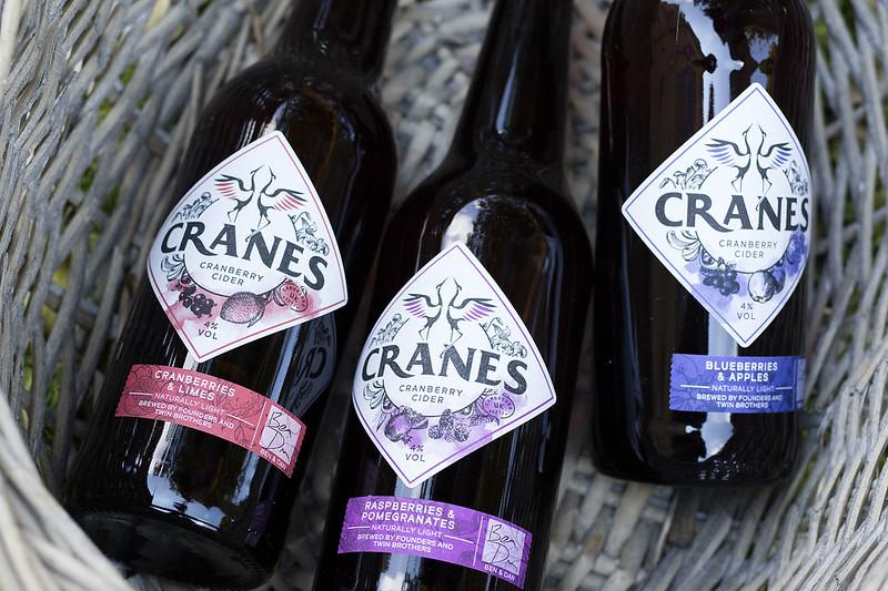 Close up of cider bottles - cranes