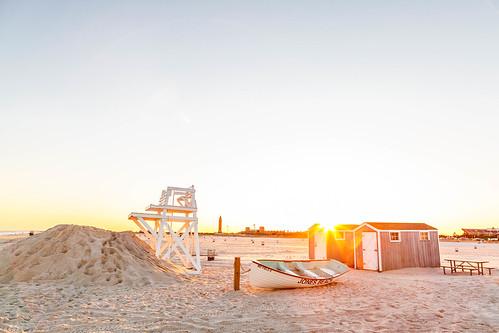 jonesbeach daytime spring sand sunset sun lifeguardchair day boat clearsky evening beach longisland wantagh newyork unitedstates us