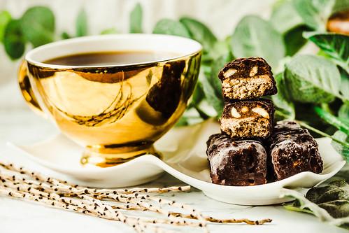 Homemade raw chocolate candy snickers bars. Vegan dessert.