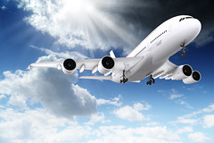 3d large passenger plane flying in the blue sky