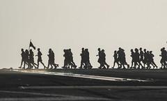 Sailors participate in a CPO 365 run on the flight deck of  USS Dwight D. Eisenhower.