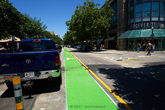Santa Cruz Public Works says that there's a two foot buffer between parked cars and the bike lane (yeah, right), but the reality is that