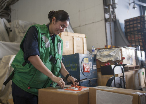 Wed, 06/21/2017 - 08:22 - 170621-N-ME396-433 MEDITERRANEAN SEA (June 21, 2017) Logistics Specialist 3rd Class Daisy Romero sorts goods aboard the aircraft carrier USS George H.W. Bush (CVN 77) (GHWB) during a replenishment-at-sea. GHWB, part of the George H.W. Bush Carrier Strike Group (GHWBCSG), is conducting naval operations in the U.S. 6th Fleet area of operations in support of U.S. national security interests in Europe and Africa. (U.S. Navy photo by Mass Communication Specialist 3rd Class Tristan B. Lotz/Released)