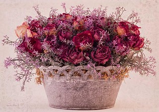 A floral arrangement of dried #rose #flowers in a trellis edged rustic tin container. #flowerarrangement #driedroses #driedflowers #driedflowersbouquet #roseart #driedflowerart #sandrafoster #sandrafosterphotography Product images can be found in my Portf