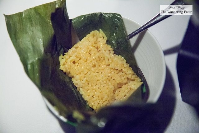 Coconut and tumeric steamed rice cake in banana leaf