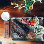 Ready to grub? We always are. We have a BBQ platter special going on only for today! (Details below) Ask for our house beer we made with Whalers called Dangerous Opinions IPA to accompany it. :raised_hands: - - - Cherry wood smoked ribs | Coleslaw | Green