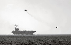 Two jets launch from USS George H.W. Bush.