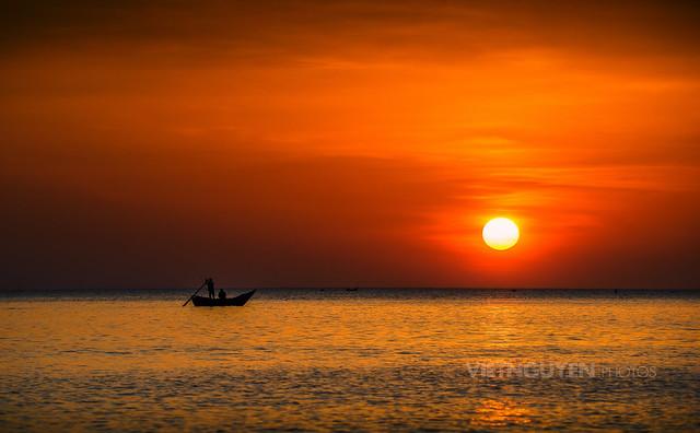Sun shining over the sea at the sunrise