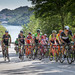 The group chasing Fabio Aru and the leading group ahead during the Road Cycling Italian Championships in Ivrea Turin Piedmont Italy with the Lago Sirio lake in the background