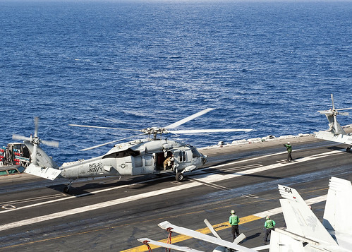 Wed, 06/21/2017 - 08:45 - 170621-N-JC445-104 MEDITERRANEAN SEA (June 21, 2017) An MH-60S Sea Hawk attached to the 'Tridents' of Helicopter Sea Combat Squadron (HSC) 9 lands aboard the aircraft carrier USS George H.W. Bush (CVN 77) (GHWB). GHWB, part of the George H.W. Bush Carrier Strike Group (GHWBCSG), is conducting naval operations in the U.S. 6th Fleet area of operations in support of U.S. national security interests in Europe and Africa. (U.S. Navy photo by Mass Communication Specialist 3rd Class Mario Coto/Released)