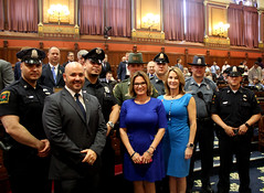 Rep. Skulczyck, Rep. Klarides-Ditria, and Rep. Klarides acknowledge various State Police officers for their hard work and dedication.