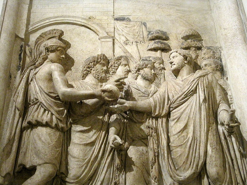 Relief from a monument of Hadrian, showing the emperor greeted by the gods and the Roman People