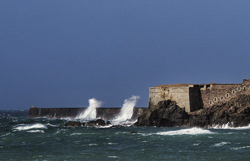 waves hitting the breakwater on Alderney | by neilalderney123