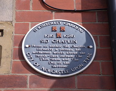 Photo of Sid Chaplin black plaque