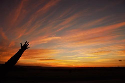 sunset hand sun sky orangesky