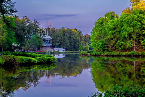 nc northcarolina cary amphitheater sky sunset green trees yellow blue purple white clouds water lake reflection serene usa america states united theater color light koka