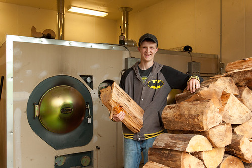 A man feeding the biomass boiler