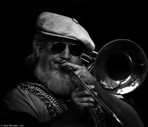 neilmoralee usa2017neilmoralee trombone man face portrait candid player musician horn brass blow slide hat dark jazz jaz blues classic honky tonk new orleans louisianna usa beard glasses shades sunnies hippy cap bearded blackbackground shade solo black white mono monochrome neil moralee nikon d7200 contrast band rock trombonist swing sound bw bandw blackandwhite people