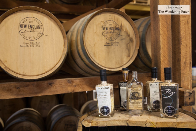 Rye and rums aging in oak barrels and display bottles