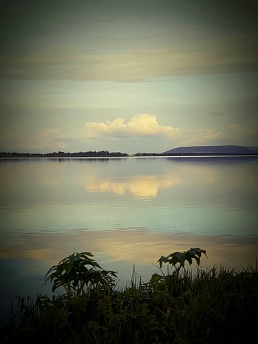 lake iceland water reflection sky clouds sunset oeiriks laugarvatn