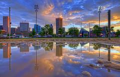 Baltimore skyline puddle reflection sunrise