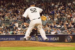 Yankees starter CC Sabathia delivers a pitch against the Red Sox in the seventh inning.