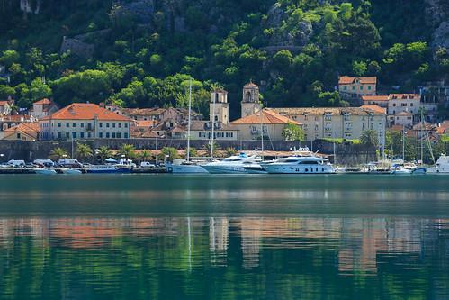 skaljari kotor montenegro crnagora bokakotorska boka morning city panorama boat reflection balkans sea adriatic bay