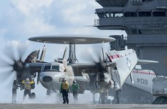 Sailors aboard USS Ronald Reagan (CVN 76) prepare to launch an E-2D Hawkeye from Airborne Early Warning Squadron (VAW) 125, May 19. (U.S. Navy/MC2 Nathan Burke)