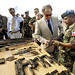 29/11/04 - Mr. Valdes, the SRSG of MINUSTAH, examines some of the weapons that the Chilean Peacekeepers have seized from the local population of Cap Haitien.
