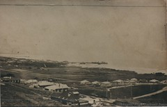 View of Byron Bay with both jetties c1935