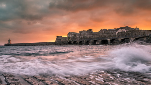 guernsey castlecornet sunrise weather cloudy sea