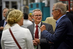 College of Textiles' Dean David Hinks (center) chats with guests attending the ribbon cutting for the new NWI facility. (Photo by Roger Winstead)