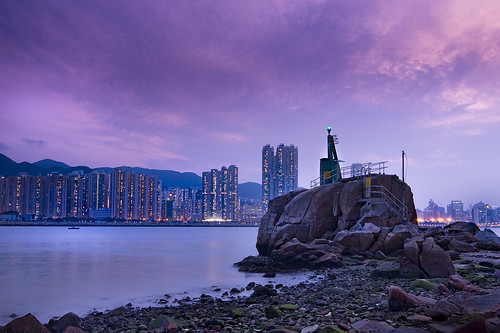 hongkong kowloon sea ocean shore coast urban night lights house buildings dusk dawn sunset sunrise city clouds outdoor sky cloud residental leiyuemun light tower rocks purple blue clam peace passion impression water waterfront