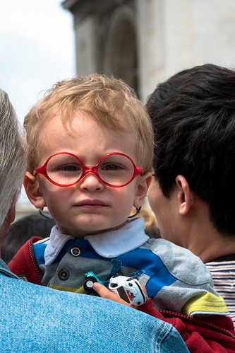 Boy at Arc De Triomphe with Red Glasses