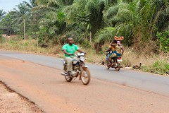 Igbo women and man, motorcycling, Obolo Village, Enugu State, Nigeria. #JujuFilms