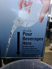 Please mix all potentially dangerous liquids in this unsecured vat, sign, Oakland Airport, California, USA