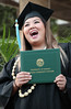 "Grad strikes an exuberant pose for official photo. (photos by Cameron Rivera)  Leeward Community College celebrated spring 2017 commencement on Friday, May 12, 2017 at Tuthill Courtyard.  For more photos from Leeward Community College's spring 2017 commencement go to:  <a href=""https://www.flickr.com/photos/leewardcc/sets/72157683964234296"">www.flickr.com/photos/leewardcc/sets/72157683964234296</a>"