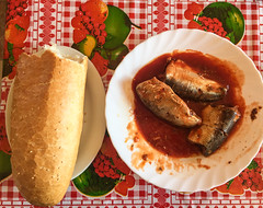 Bread with fish and tomato sauce for lunch