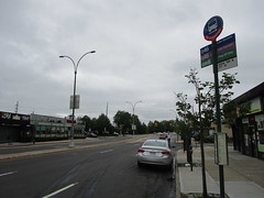The Q46 bus stops at 271st Street, the highest numbered street in New York City.  This view looks east towards the Nassau County border, which is roughly where the traffic lights are (05/29/17, IMG_4373)