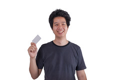 Asian adult man holding blank credit card