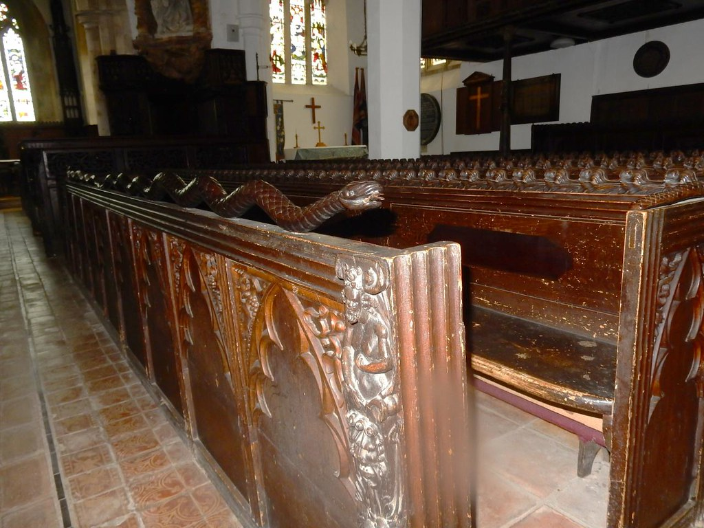 Carved pews Note the snake. Sandy to Biggleswade St Leonard's, Old Warden.