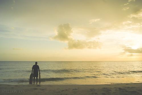 sunset ocean water waves silhouette casey key florida sea yellow light white blue beach island