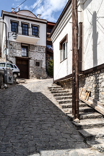 ohrid macedonia fyrom охрид македонија architecture buildings ancient old heritage city downtown innercity history street light sunlight sunshine house houses ottoman quiet peaceful quaint blue sky white clouds