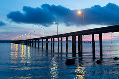Concrete Pier with Street Lamp over the Sea and Sunrise Sky.
