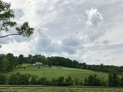 clouds building over bucolic Loudoun County countryside