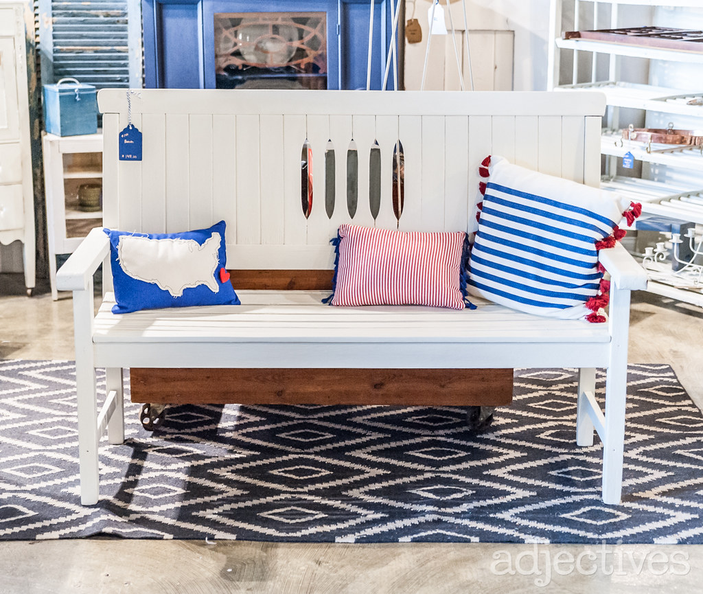 White wood bench and American throw pillows by The Collection Agency at Adjectives Altamonte
