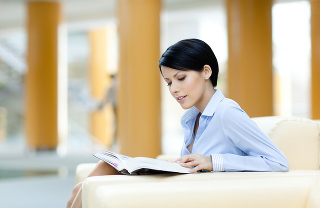 Business woman rests with book