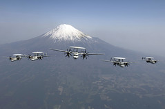 In this file photo, E-2C Hawkeyes assigned to VAW-115 fly in formation by Mt. Fuji in 2007. (U.S. Navy/MC1 Jarod Hodge)