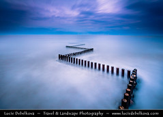 UK - England - East Anglia - Norfolk - Great Yarmouth - Zig Zag wave breaker poles during stormy evening